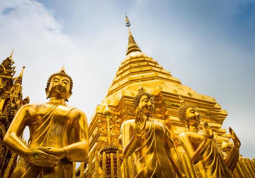 Golden Buddha statues and main stupa in Doi Suthep