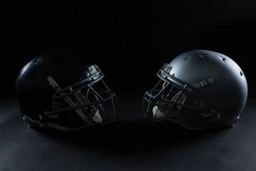 American football head gear facing each other