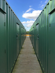 Shipping containers converted into storage units in a line.