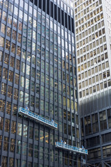 two window cleaning crews working in heights at office tower downtown Toronto