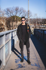 Young Man Dressed in Black Posing Tough in Urban Area