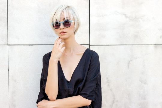 Portrait of a blond short hair female model with sunglasses