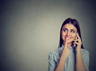 Girl calling with a mobile phone smiling