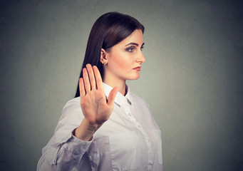 angry woman giving talk to hand gesture with palm outward