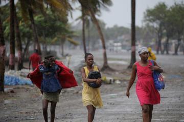 Women walk in the rain brought by Hurricane Irma in Cap-Haitien