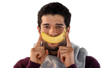 Portrait of smiling man holding banana
