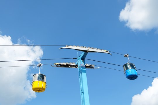 Cable car ride against a cloudy sky.