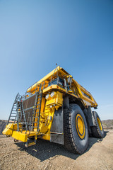 Big yellow mining truck at worksite