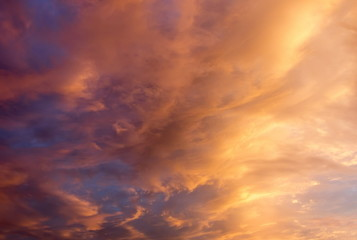 Beautiful clouds at sunset, improbable sky