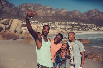 Best friends taking a selfie on the beach