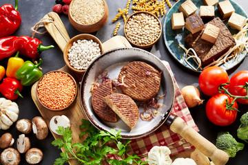 Rustic vegetarian ingredients on timber table