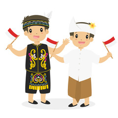 two happy boys in Dayak and Bali traditional dress holding Indonesian flag cartoon vector