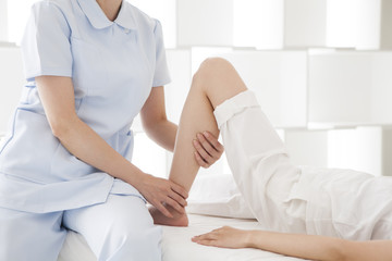 A woman receiving a calf massage