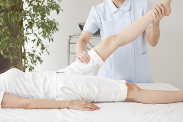 Foot treatment by female massage practitioner