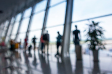 Abstract blurred in airport terminal, Travelers tourist waiting at boarding gate before departure