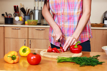 Closeup shot of a woman preparing a salad