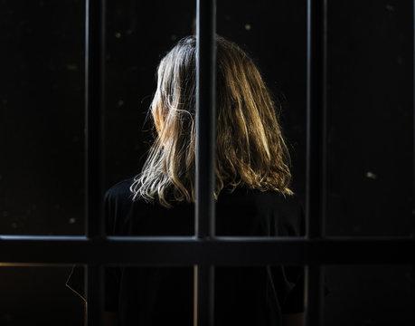 Caucasian woman in a jail