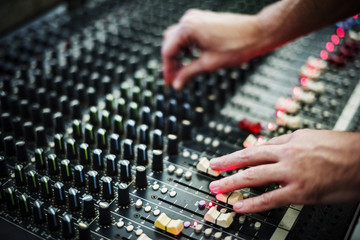 Hand on a sound mixer station