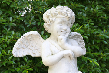 Cupid sculpture in the garden.