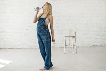 pregnant woman drinks fresh bottle water
