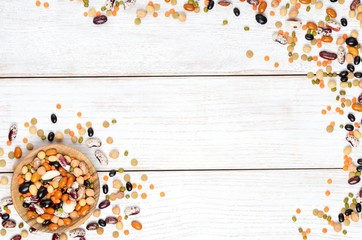 Dry legumes on white wooden background, top view. Copyspace background.
