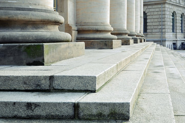 Classical column bases and concrete staircase in perspective. Architectural geometric  composition.
