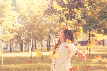 Happy Autumn. Beautiful Woman  Fashion Model Having Fun in Fall Park Outdoors