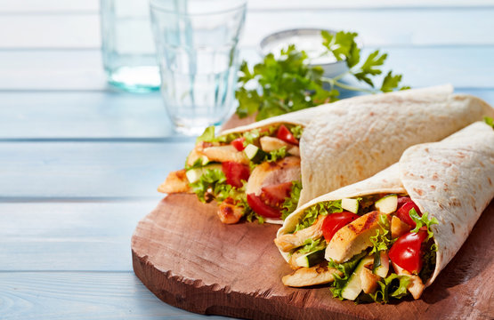 Two fresh chicken and salad tortilla wraps
