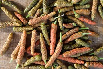 Fototapeta Long pepper or Piper longum on wooden table obraz