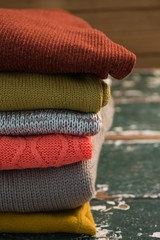 Close up of colorful stack of sweaters