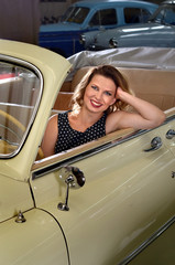 fashionable woman sitting in retro car