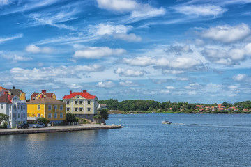 KARLSKRONA, SWEDEN - 2017 July. Typical red Swedish wooden houses with natiaonal flag in the city of Karlskrona