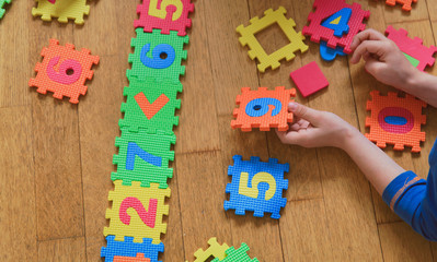 child playing with puzzle, education concept