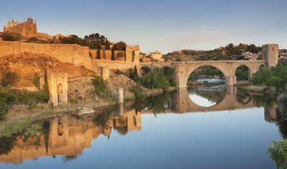 Puente de San Martin Bridge and San Juan des los Reyes Monastery reflected in the Tajo River, Toledo, Castilla-La Mancha, Spain, Europe