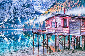 Wall Mural - Wooden boat house at Lago di Braies in South Tyrol, Italian mountain alpine region, famous and very popular travel destination area in Europe. Beautiful fall scenery at mountain lake.