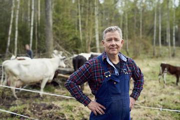Portrait of confident farmer standing on field