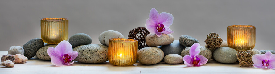 Stores à enrouleur Orchidée concept of wellbeing with pebbles, orchids and candles, panoramic