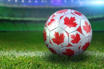 Canada Soccer Ball on Stadium Green Grasses at Night