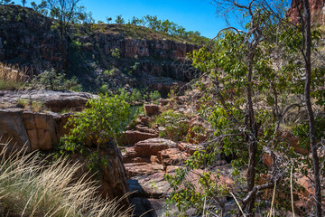 Rocky escarpment on the sides of the river at Katherine Gorge on a beautiful sunny day in Nitmiluk National Park, Northern Territory, Australia.