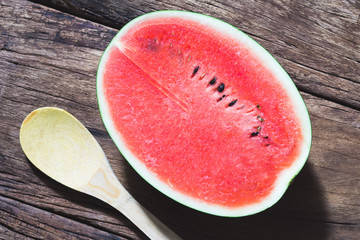 Half piece of watermelon on wood background