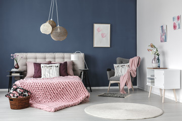 Pastel bedroom with designed lamp