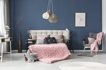 Grey armchair with pink blanket