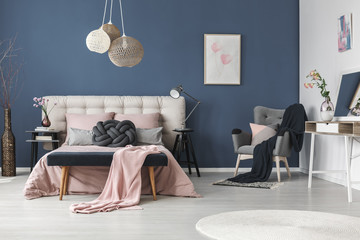 Black blanket on grey armchair