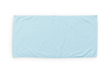 Light blue beach towel mock up isolated on white background, flat lay top view