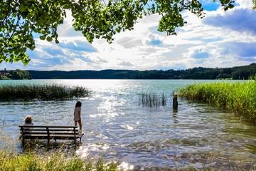"""A beautiful seat on a bench in the lake of Buckow in the Märkische Schweiz at Schermützelsee. """