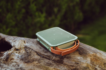 Cool green Wireless speaker playing in a park