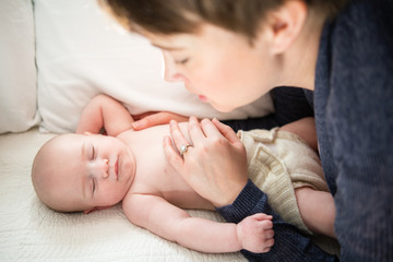 Mother watching baby son sleep