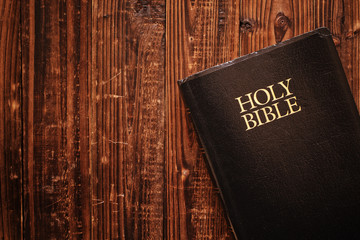 Holy Bible on wood in natural light Wall mural