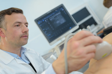 doctor with patient undergoing arm echography