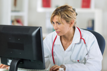 doctor is checking results on her computer